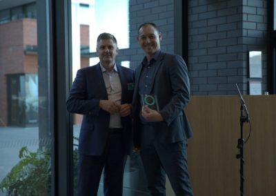 Mark congratulates a Medium business finalist in the SPTW awards Nov 2018